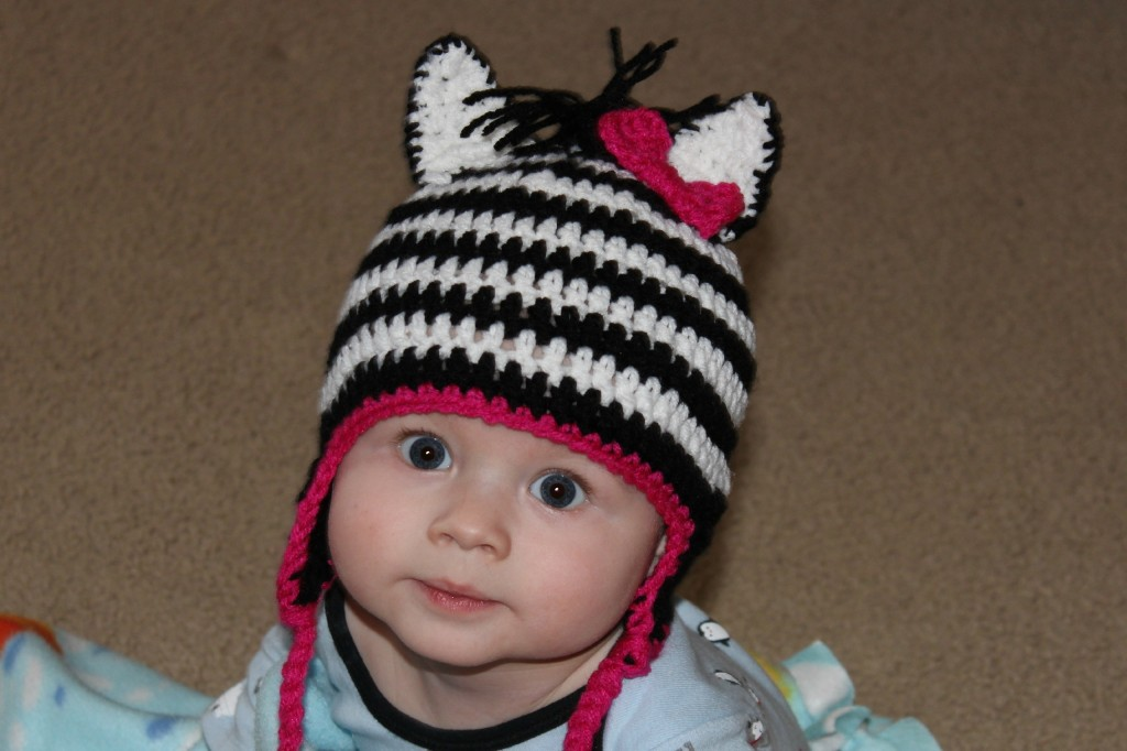 Adorable Zebra hat with pink accents and a pink bow!